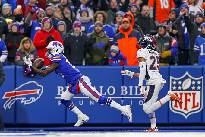 Buffalo Bills wide receiver John Brown (15) makes a diving catch for a touchdown against Denver Broncos cornerback Chris Harris (25) during the fourth quarter of an NFL football game, Sunday, Nov. 24, 2019, in Orchard Park, N.Y. (AP Photo/John Munson)