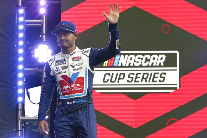 Kyle Larson waves to fans during driver introductions before the NASCAR Cup Series auto race at Daytona International Speedway, Saturday, Aug. 28, 2021, in Daytona Beach, Fla. (AP Photo/John Raoux)