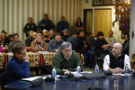 Attorney General William Barr speaks at a Confederated Salish and Kootenai Tribes council meeting, Friday, Nov. 22, 2019, on the Flathead Reservation in Pablo, Mont. Sitting with Barr are Kurt Alme, left, U.S. Attorney for the District of Montana, and Tracy Toulou, director of the Justice Department's Office of Tribal Justice. (AP Photo/Patrick Semansky)