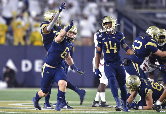 Georgia Tech linebacker David Curry (6) celebrates during the first half of the team's NCAA college football game against Louisville on Friday, Oct. 9, 2020, in Atlanta. (Hyosub Shin/Atlanta Journal-Constitution via AP)