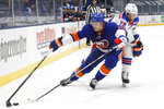 New York Islanders' Adam Pelech (3) fights for possession against New York Rangers' K'Andre Miller (79) during the second period of an NHL hockey game Friday, April 9, 2021, in Uniondale, N.Y. (AP Photo/Jason DeCrow)