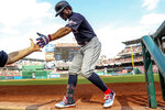 Cleveland Indians Francisco Lindor returns to the dugout after scoring on a solo home run during the third inning of a baseball game against the Washington Nationals at Nationals Park, Sunday, Sept. 29, 2019, in Washington. (AP Photo/Andrew Harnik)