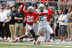 Ohio State defensive back Cameron Brown, left, knocks the ball away from Oregon receiver Devon Williams during the first half of an NCAA college football game Saturday, Sept. 11, 2021, in Columbus, Ohio. (AP Photo/Jay LaPrete)