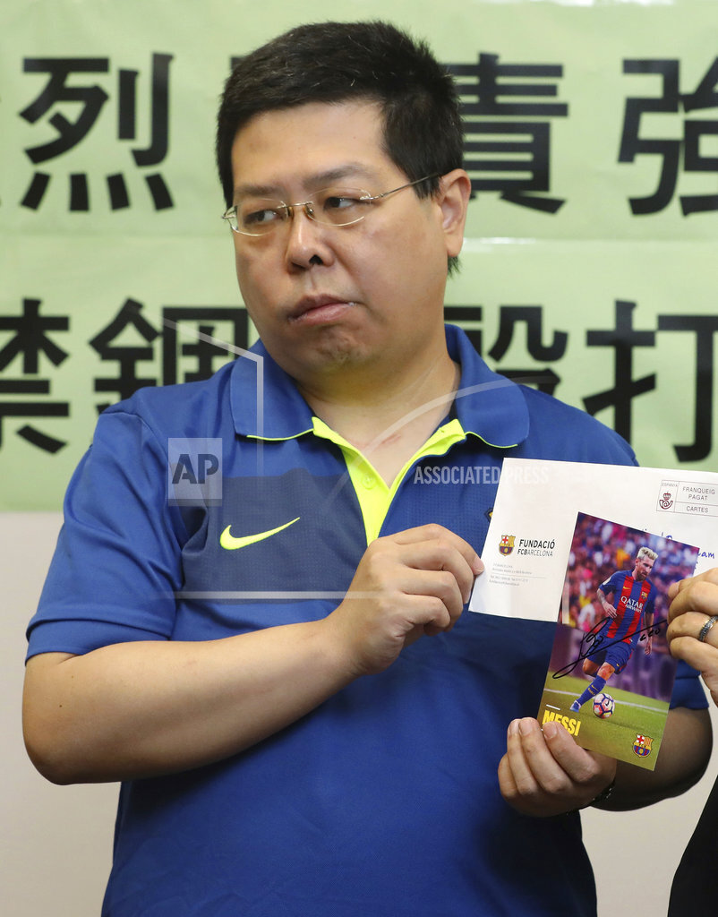 Hong Kong activist says Chinese tortured him for Messi photo