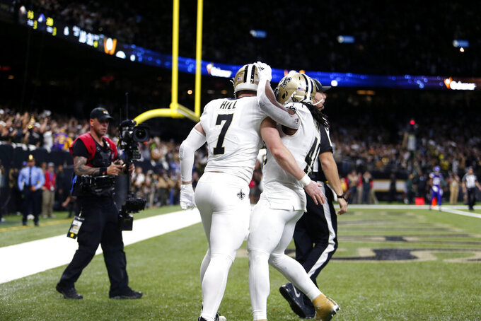 New Orleans Saints quarterback Taysom Hill (7) celebrates his touchdown reception with running back Alvin Kamara (41) in the second half of an NFL wild-card playoff football game against the Minnesota Vikings, Sunday, Jan. 5, 2020, in New Orleans. (AP Photo/Brett Duke)
