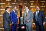 The coaches of the four teams in the College Football Playoff, from left, Alabama's Nick Saban, Oklahoma's Lincoln Riley, Clemson's Dabo Swinney and Notre Dame's Brian Kelly chat after a news conference Thursday, Dec. 6, 2018, in Atlanta. Alabama will face Oklahoma in the Orange Bowl and Clemson and Notre Dame will play in the Cotton Bowl. (AP Photo/John Bazemore)