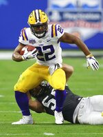 LSU running back Clyde Edwards-Helaire (22) breaks away from UCF linebacker Pat Jasinski (56) during the first half of the Fiesta Bowl NCAA college football game Tuesday, Jan. 1, 2019, in Glendale, Ariz. (AP Photo/Ross D. Franklin)