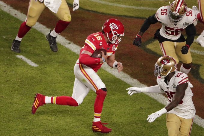 Kansas City Chiefs quarterback Patrick Mahomes (15) runs for a touchdown, during the first half of the NFL Super Bowl 54 football game, Sunday, Feb. 2, 2020, in Miami Gardens, Fla. (AP Photo/Charlie Riedel)