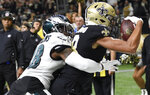 New Orleans Saints wide receiver Keith Kirkwood (18) pulls in a touchdown reception in front of Philadelphia Eagles cornerback Josh Hawkins (48) in the first half of an NFL divisional playoff football game in New Orleans, Sunday, Jan. 13, 2019. (AP Photo/Bill Feig)