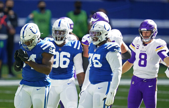 Indianapolis Colts defensive end Tyquan Lewis (94) celebrates a sack of Minnesota Vikings quarterback Kirk Cousins (8) during the second half of an NFL football game, Sunday, Sept. 20, 2020, in Indianapolis. (AP Photo/Michael Conroy)