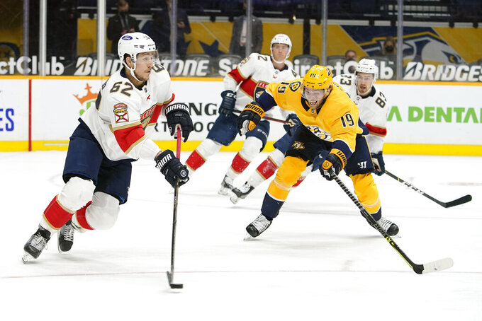 Florida Panthers defenseman Brandon Montour (62) moves the puck past Nashville Predators center Calle Jarnkrok (19) in the second period of an NHL hockey game Tuesday, April 27, 2021, in Nashville, Tenn. (AP Photo/Mark Humphrey)