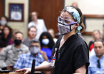 Dr. Leslie Hutchins speaks in favor of masks during the Abilene Independent School District board meeting in Abilene, Texas, Monday, Aug. 30, 2021. A doctor at Hendrick Medical Center, said some of her patients have died waiting for beds which are taken by COVID-19 patients. (Ronald W. Erdrich/The Abilene Reporter-News via AP)