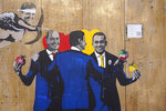 A graffitti by Italian street artist TvBoy shows from left former Premier Matteo Renzi, Democratic Party leader Nicola Zingaretti, Premier Giuseppe Conte, and 5-Star Movement's Luigi Di Maio, in Rome, Friday, Sept. 6, 2019. Conte's first, 14-month-long coalition imploded last month after the right-wing League, led by Matteo Salvini, pulled out of a government it had formed with the populist 5-Star Movement, in the new government, the staunchly pro-Europe, center-left Democratic Party replaced the League as junior coalition partner. (AP Photo/Andrew Medichini)