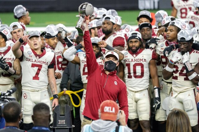 Oklahoma head coach Lincoln Riley hosts the Big 12 Conference championship trophy after defeating Iowa State 27-21 in an NCAA college football game, Saturday, Dec. 19, 2020, in Arlington, Texas. (AP Photo/Jeffrey McWhorter)