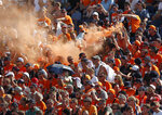 Fans of Red Bull driver Max Verstappen of the Netherlands celebrate on the stands during the qualifying session for the Hungarian Formula One Grand Prix, at the Hungaroring racetrack in Mogyorod, Hungary, Saturday, July 31, 2021. The Hungarian Formula One Grand Prix will be held on Sunday. (David W Cerny/Pool via AP)