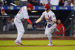 """St. Louis Cardinals third base coach Ron """"Pop"""" Warner celebrates with Tyler O'Neill, right, after O'Neill hit a two-run home run during the eighth inning of the team's baseball game against the New York Mets on Tuesday, Sept. 14, 2021, in New York. (AP Photo/Frank Franklin II)"""