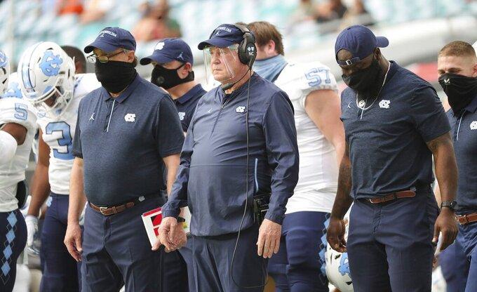 North Carolina head coach Mack Brown watches from the sideline during an NCAA college football game against Miami at Hard Rock Stadium In Miami Gardens, Fla, Saturday, Dec, 12, 2020. (Al Diaz/Miami Herald via AP)