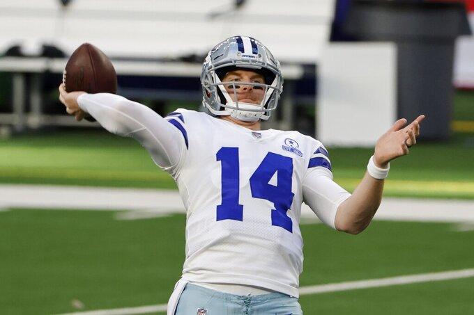 Dallas Cowboys quarterback Andy Dalton (14) warms up before an NFL football game against the Philadelphia Eagles in Arlington, Texas, Sunday, Dec. 27. 2020. (AP Photo/Michael Ainsworth)