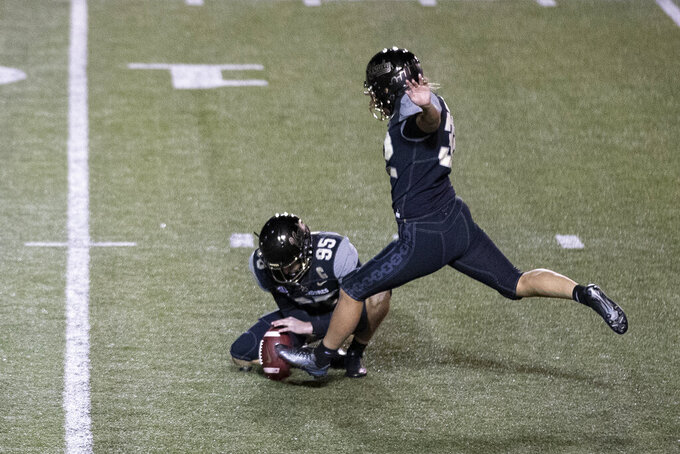 Vanderbilt's Sarah Fuller, right, kicks an extra point as Harrison Smith (95) holds during the second half of an NCAA college football game against Tennessee, Saturday, Dec. 12, 2020, in Nashville, Tenn. (AP Photo/Wade Payne)