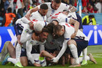 England's Harry Kane, bottom, celebrates with his teammates after scoring his side's second goal during the Euro 2020 soccer semifinal match between England and Denmark at Wembley stadium in London, Wednesday, July 7, 2021. (Laurence Griffiths/Pool Photo via AP)