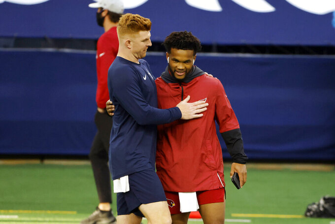 Dallas Cowboys quarterback Andy Dalton, left, and Arizona Cardinals quarterback Kyler Murray greet each other on the field during warmups before an NFL football game in Arlington, Texas, Monday, Oct. 19, 2020. (AP Photo/Ron Jenkins)