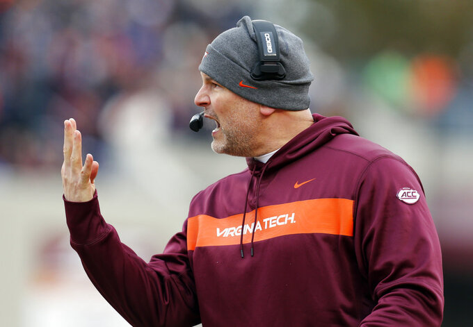FILE - In this Nov. 23, 2018, file photo, Virginia Tech head coach Justin Funente directs his team during the first half of an NCAA college football game against Virginia, in Blacksburg, Va. A victory by Marshall (8-3) would end the Hokies' nation's-best 25-year bowl streak, and leave one more spot open for other teams seeking the best postseason destination available. But Virginia Tech (5-6) has other plans. (AP Photo/Steve Helber, File)