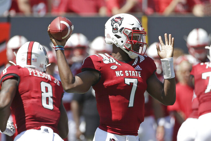 North Carolina State quarterback Matthew McKay (7) passes during the first half of an NCAA college football game against East Carolina in Raleigh, N.C., Saturday, Aug. 31, 2019. (AP Photo/Gerry Broome)