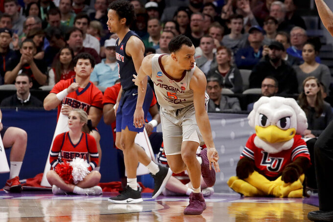 Virginia Tech guard Justin Robinson (5) celebrates after scoring against Liberty during the first half of a second-round game in the NCAA men's college basketball tournament Sunday, March 24, 2019, in San Jose, Calif. (AP Photo/Jeff Chiu)