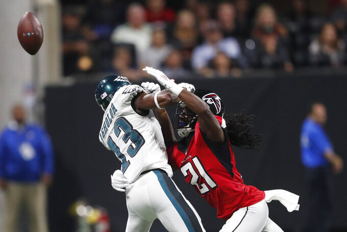Atlanta Falcons cornerback Desmond Trufant (21) hits Philadelphia Eagles wide receiver Nelson Agholor (13) during the first half of an NFL football game, Sunday, Sept. 15, 2019, in Atlanta. (AP Photo/John Bazemore)