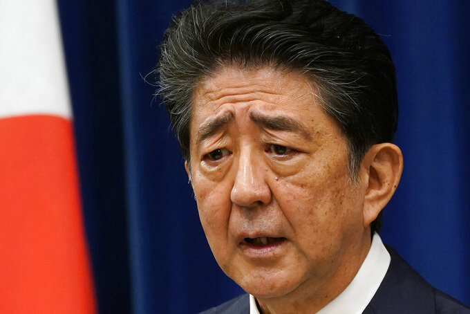 Japanese Prime Minister Shinzo Abe speaks during a press conference at the prime minister official residence in Tokyo Friday, Aug. 28, 2020. Abe was a star of the closing ceremony of the 2016 Rio de Janeiro Olympics, parading before a 70,000 sellout at the Maracana stadium as Nintendo game character Super Mario. It was Abe's humorous invitation to the next Olympics in Tokyo. It turns out that Abe won't be around, at least not in an official capacity, when the postponed Olympics are set to open on July 23, 2021. (Franck Robichon/Pool Photo via AP)