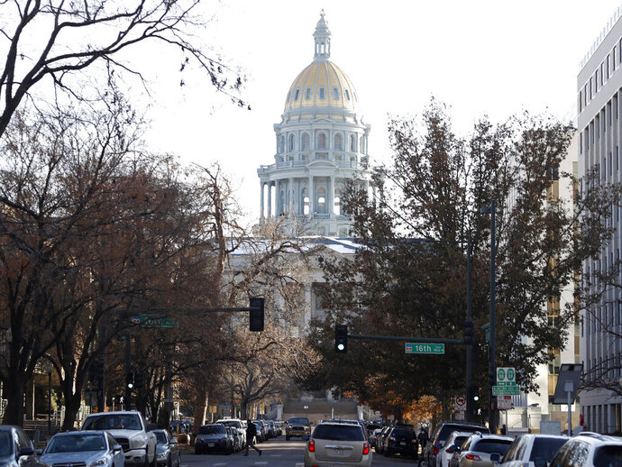 In this Monday, Nov. 4, 2019, photo, the Colorado State Capitol building stands at the base of Grant Street in downtown Denver. An investigation by The Denver Post has shown that many Colorado government agencies are swiftly and regularly purging their employees' emails, the result of inconsistent retention policies across state government offices that are subject to public records laws. (AP Photo/David Zalubowski)