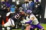 Houston Texans cornerback Bradley Roby (21) breaks up a pass intended for Minnesota Vikings wide receiver Adam Thielen (19) during the second half of an NFL football game Sunday, Oct. 4, 2020, in Houston. (AP Photo/David J. Phillip)