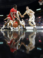 Bradley's Darrell Brown (5) drives to the basket as Loyola of Chicago's Cameron Krutwig (25) defends during the second half of an NCAA college basketball game in the semifinal round of the Missouri Valley Conference tournament, Saturday, March 9, 2019, in St. Louis. Bradley won 53-51. (AP Photo/Jeff Roberson)