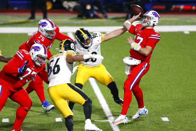 Buffalo Bills quarterback Josh Allen (17) gets off a pass under pressure from Pittsburgh Steelers outside linebacker T.J. Watt (90) during the first half of an NFL football game in Orchard Park, N.Y., Sunday, Dec. 13, 2020. The Bills won 26-15. (AP Photo/Jeffrey T. Barnes )