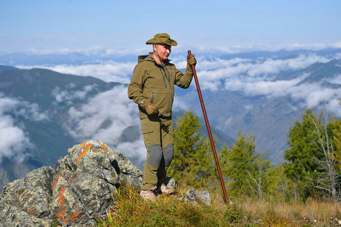 In this undated photo released by Russian Presidential Press Service, Russian President Vladimir Putin stands on a hill in Siberia during a break from state affairs ahead of his birthday. Russian president chose the Siberian taiga forest to go on a hike ahead of his birthday on Oct. 7. (Alexei Druzhinin, Sputnik, Kremlin Pool Photo via AP)