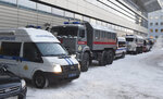 Russian Rosguardia (National Guard) and police buses stand prior to Alexei Navalny's arrival, at the Vnukovo airport, outside Moscow, Russia, Sunday, Jan. 17, 2021.  Leading Kremlin critic Alexei Navalny plans to fly home to Russia on Sunday after recovering in Germany from his poisoning in August with a nerve agent. (AP Photo/Dmitry Serebryakov)