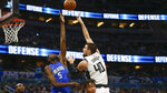 Los Angeles Clippers center Ivica Zubac (40) shoots over Orlando Magic center Mo Bamba (5) during the second quarter of an NBA basketball game in Orlando, Fla., Sunday, Jan. 26, 2020. (AP Photo/Reinhold Matay)