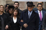 Roger Stone with accompanied by his wife Nydia Stone, second from left, arrives at federal court in Washington, Thursday, Feb. 20, 2020. Roger Stone, a staunch ally of President Donald Trump, faces sentencing Thursday on his convictions for witness tampering and lying to Congress. (AP Photo/Manuel Balce Ceneta)