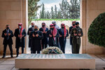 FILE - This April 11, 2021 file photo from the Royal Court twitter account, shows Jordan's King Abdullah II, center, Prince Prince Hamzah, second left, and others during a visit to the tomb of the late King Hussein, in Amman Jordan. Jordan's version of a trial of the century gets under way as early as Monday, June 21, 2021. A relative of King Abdullah II and a former chief of the royal court will be ushered into the defendants' cage at the state security court to face sedition charges. They are accused of conspiring with Prince Hamzah, a half-brother of the king, to foment unrest against the monarch. (Royal Court Twitter Account via AP, File)