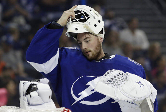 FILE - In this Sept. 22, 2018, file photo, Tampa Bay Lightning goaltender Connor Ingram is shown during the third period of an NHL preseason hockey game against the Nashville Predators, in Tampa, Fla. The Nashville Predators have signed goaltender Connor Ingram to a three-year contract. Predators general manager David Poile announced the deal Monday, March 23, 2020. (AP Photo/Chris O'Meara, File)