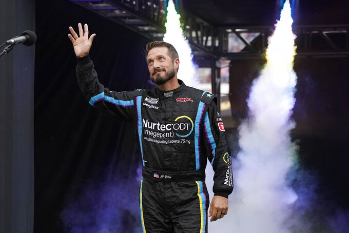 JJ Yeley waves to fans before a NASCAR Cup Series auto race at Bristol Motor Speedway Saturday, Sept. 18, 2021, in Bristol, Tenn. (AP Photo/Mark Humphrey)