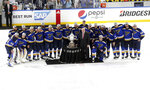 Members of the St. Louis Blues are presented the Clarence S. Campbell Bowl by NHL deputy commissioner Bill Daly after defeating the San Jose Sharks in Game 6 of the NHL hockey Stanley Cup Western Conference final series Tuesday, May 21, 2019, in St. Louis. The Blues won 5-1 to take the series 4-2. (AP Photo/Tom Gannam)