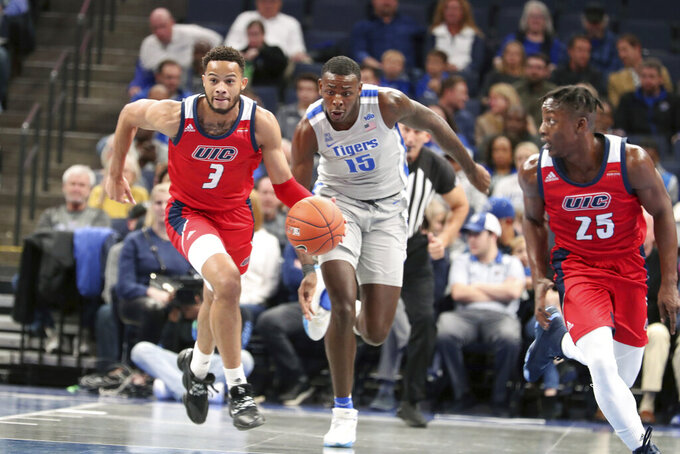 Memphis' Lance Thomas (15) and Illinois-Chicago's Jacob Wiley (3) head down court during the first half of an NCAA college basketball game Friday, Nov. 8, 2019, in Memphis, Tenn. (AP Photo/Karen Pulfer Focht)