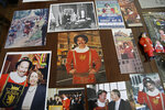 In this photo taken Tuesday, Jan. 7, 2020, photographs and memorabilia belonging to Beefeater doorman Tom Sweeney cover a table at his home in San Francisco. The photograph at center shows Sweeney when he began his job in 1976 and from lower left he is seen with U.S. House Speaker Nancy Pelosi, actress Sharon Stone and former British Prime Minister Tony Blair. Sweeney has opened doors for movie stars and shaken hands with every U.S. president since Gerald Ford, with the exception of Donald Trump. He's taken photos with countless visitors from around the world, often after telling them where to catch the cable car and how to get to Fisherman's Wharf. The man known as a