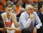 Syracuse coach Jim Boeheim, right, and his son Buddy Boeheim, left, sit on the bench in the final minutes of the team's NCAA college basketball game against Duke in Syracuse, N.Y., Saturday, Feb. 23, 2019. Duke won 75-65. (AP Photo/Nick Lisi)