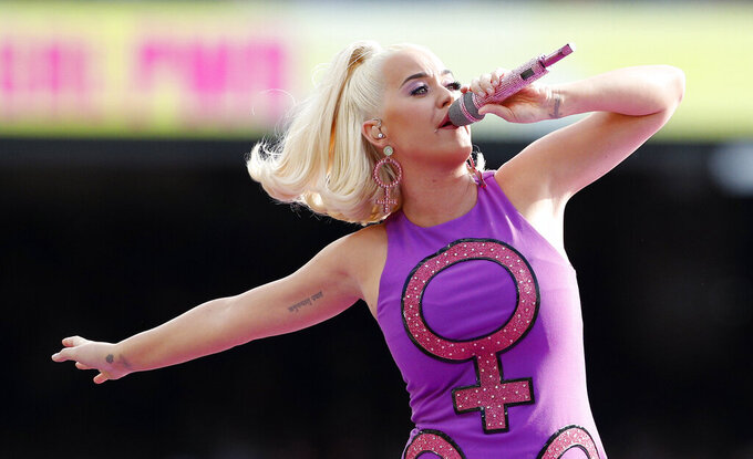 """FILE - Katy Perry performs prior to the Women's T20 World Cup cricket final match between Australia and India in Melbourne March 8, 2020. Perry's latest album """"Smile"""" will be released on Friday, Aug. 28.  (AP Photo/Asanka Ratnayake, File)"""