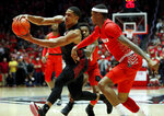 San Diego State forward Matt Mitchell, left, drives to the basket as New Mexico guard Keith McGee defends during the first half of an NCAA college basketball game on Wednesday, Jan. 29, 2020 in Albuquerque, N.M. (AP Photo/Andres Leighton)