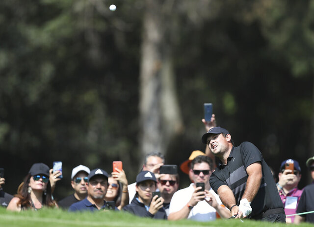 Patrick Reed of United States approaches to the third green during the final round for the WGC-Mexico Championship golf tournament, at the Chapultepec Golf Club in Mexico City, Sunday, Feb. 23, 2020.(AP Photo/Fernando Llano)