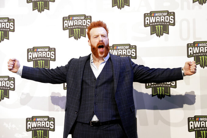 """FILE - In this Dec. 5, 2019 file photo, professional wrestler and actor Sheamus arrives at the NASCAR Cup Series Awards in Nashville, Tenn. The WWE star is offering ring-side seats and """"many beers"""" to anyone who returns a prop cross necklace that was stolen in May 2021 from an arena on the campus of the University of South Florida. Crime Stoppers of Tampa Bay is also offering a $5,000 reward for information about the theft of the necklace, three title belts signed by various WWE stars and a corner pad. Police say the theft happened in the early morning hours of May 22 at the Yuengling Center. (AP Photo/Mark Humphrey, File)"""