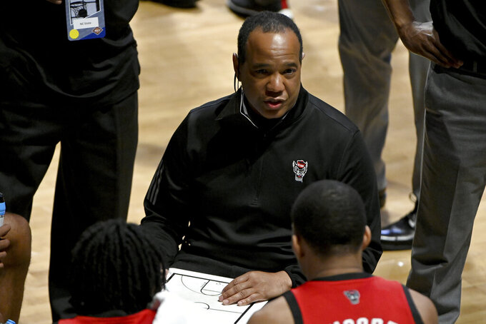 North Carolina State head coach Kevin Keatts talks to his team during timeout in the second half of an NCAA college basketball game against Davidson in the first round of the NIT, Thursday, March 18, 2021, in Denton, Texas. North Carolina State won 75-61. (AP Photo/Matt Strasen)